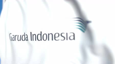 symbolic : Waving flag with Garuda Indonesia logo, close-up. Editorial loopable 3D animation