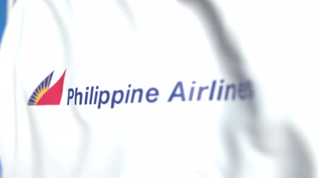 philippine : Flying flag with Philippine Airlines logo, close-up. Editorial loopable 3D animation Stock Footage