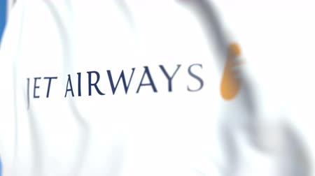 symbolic : Flying flag with Jet Airways logo, close-up. Editorial loopable 3D animation