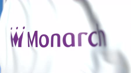 monarch : Flying flag with Monarch Airlines logo, close-up. Editorial loopable 3D animation