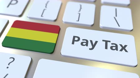 Боливия : PAY TAX text and flag of Bolivia on the buttons on the computer keyboard. Taxation related conceptual 3D animation