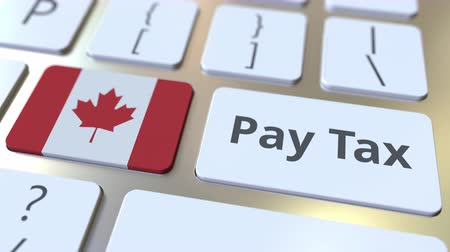 canadense : PAY TAX text and flag of Canada on the buttons on the computer keyboard. Taxation related conceptual 3D animation Stock Footage