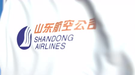 symbolic : Waving flag with Shandong Airlines logo, close-up. Editorial loopable 3D animation