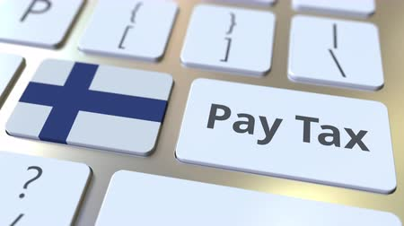 finlandiya : PAY TAX text and flag of Finland on the buttons on the computer keyboard. Taxation related conceptual 3D animation