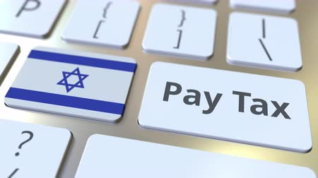 ebreo : PAY TAX text and flag of Israel on the buttons on the computer keyboard. Taxation related conceptual 3D animation Filmati Stock