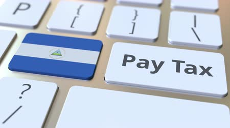 nicaraguan : PAY TAX text and flag of Nicaragua on the buttons on the computer keyboard. Taxation related conceptual 3D animation Stock Footage