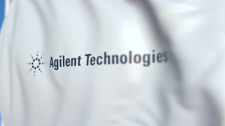 flapping : Waving flag with Agilent Technologies logo, close-up. Editorial loopable 3D animation
