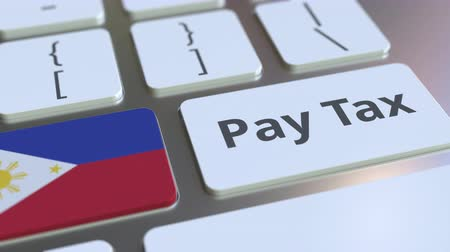 servizi informatici : PAY TAX text and flag of Philippines on the computer keyboard. Taxation related conceptual 3D animation