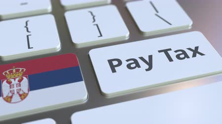 sérvia : PAY TAX text and flag of Serbia on the computer keyboard. Taxation related conceptual 3D animation Vídeos