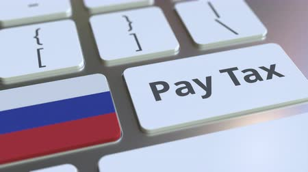 taxatie : PAY TAX text and flag of Russia on the computer keyboard. Taxation related conceptual 3D animation