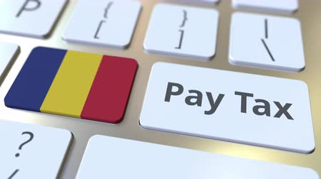 romeno : PAY TAX text and flag of Romania on the computer keyboard. Taxation related conceptual 3D animation