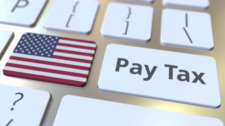 taxatie : PAY TAX text and flag of the United States on the buttons on the computer keyboard. Taxation related conceptual 3D animation