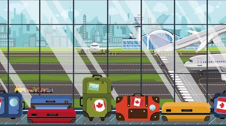 istek : Suitcases with Canada flag stickers on baggage carousel in airport. Canadian tourism related loopable cartoon animation