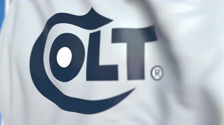 oficial : Waving flag with Colts Manufacturing Company logo, close-up. Editorial loopable 3D animation Vídeos