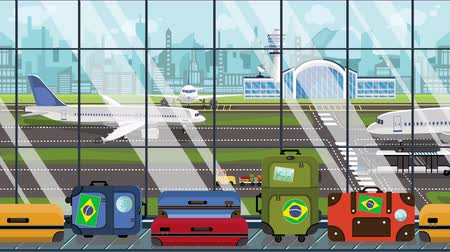 istek : Luggage with Brazil flag stickers on baggage carousel in airport. Brazilian tourism conceptual loopable cartoon animation