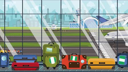 istek : Suitcases with Nigerian flag stickers on baggage carousel in airport. Travel to Nigeria related loopable cartoon animation
