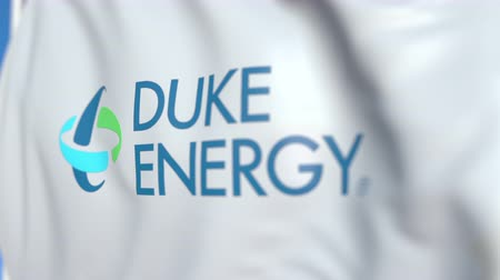 duca : Flying flag with Duke Energy logo, close-up. Editorial loopable 3D animation