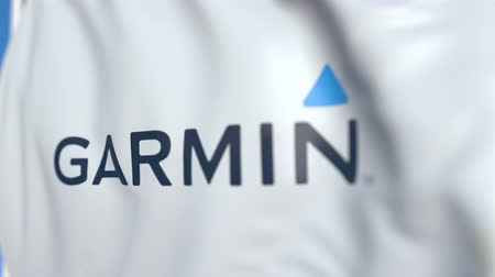 flapping : Waving flag with Garmin logo, close-up. Editorial loopable 3D animation