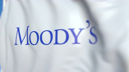 flapping : Waving flag with Moodys Corporation logo, close-up. Editorial loopable 3D animation