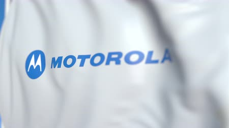oficial : Flying flag with Motorola logo, close-up. Editorial loopable 3D animation