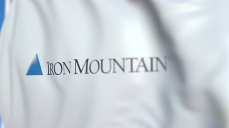 pólos : Waving flag with Iron Mountain logo, close-up. Editorial loopable 3D animation