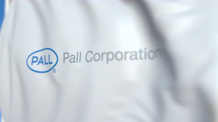 знак : Waving flag with Pall Corporation logo, close-up. Editorial loopable 3D animation