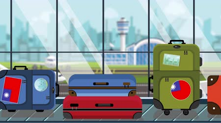 istek : Suitcases with Taiwanese flag stickers on baggage carousel in airport, close-up. Tourism in Taiwan related loopable cartoon animation