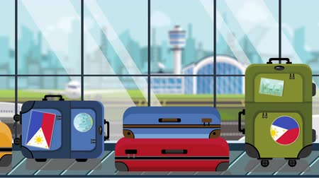 toon : Suitcases with Philippines flag stickers on baggage carousel in airport, close-up. Tourism related loopable cartoon animation