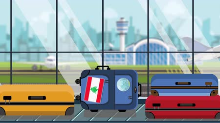 istek : Suitcases with Lebanese flag stickers on baggage carousel in airport, close-up. Travel to Lebanon related loopable cartoon animation