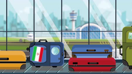 istek : Suitcases with Iranian flag stickers on baggage carousel in airport, close-up. Travel to Iran related loopable cartoon animation Stok Video