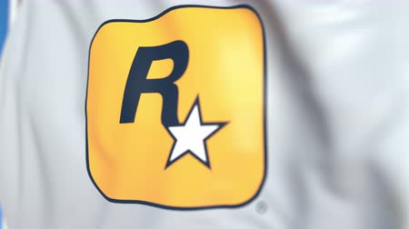flapping : Flying flag with Rockstar Games logo, close-up. Editorial loopable 3D animation Stock Footage