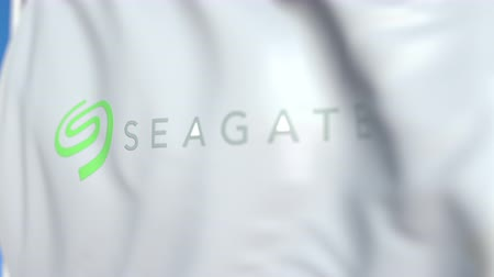 flapping : Flying flag with Seagate Technology logo, close-up. Editorial loopable 3D animation Stock Footage