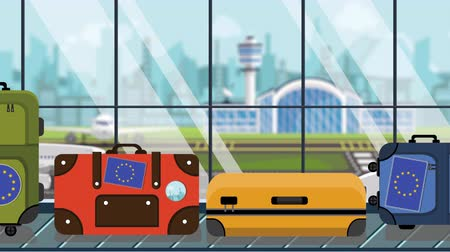 toon : Suitcases with EU flag stickers on baggage carousel in airport, close-up. European tourism related loopable cartoon animation
