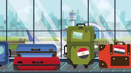 toon : Suitcases with Egyptian flag stickers on baggage carousel in airport, close-up. Travel to Egypt related loopable cartoon animation