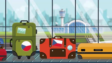 toon : Suitcases with Czech flag stickers on baggage carousel in airport, close-up. Tourism in the Czech Republic related loopable cartoon animation
