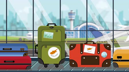 toon : Suitcases with Cypriot flag stickers on baggage carousel in airport, close-up. Tourism in Cyprus related loopable cartoon animation