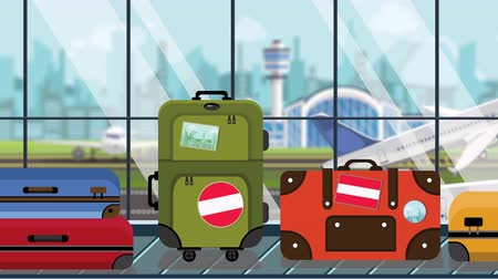 toon : Suitcases with Austrian flag stickers on baggage carousel in airport, close-up. Tourism in Austria related loopable cartoon animation