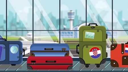 toon : Baggage with Croatian flag stickers on baggage carousel in airport, close-up. Tourism in Croatia related loopable cartoon animation