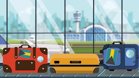toon : Suitcases with Bahamian flag stickers on baggage carousel in airport, close-up. Tourism in Bahamas related loopable cartoon animation