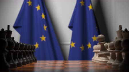 pedina : Flags of the European Union behind chess board. The first pawn moves in the beginning of the game. Political rivalry conceptual 3D animation