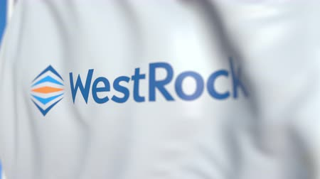 flapping : Waving flag with Westrock logo, close-up. Editorial loopable 3D animation Stock Footage