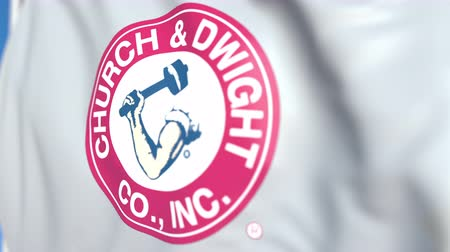pólos : Flying flag with Church & Dwight Co., Inc. logo, close-up. Editorial loopable 3D animation Vídeos