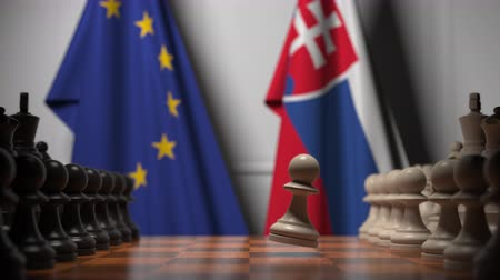 peão : Flags of the EU and Slovakia behind chess board. The first pawn moves in the beginning of the game. Political rivalry conceptual 3D animation