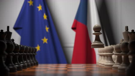 pieza de ajedrez : Flags of the EU and the Czech Republic behind chess board. The first pawn moves in the beginning of the game. Political rivalry conceptual 3D animation