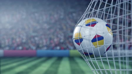 reaching : Flag of Colombia on the football hitting goal net back. Realistic slow motion 3D animation