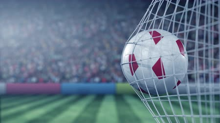maltština : Flag of Malta on the football hitting goal net back. Realistic slow motion 3D animation