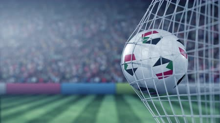 sudanian : Flag of Sudan on the ball in football net. Conceptual 3D animation