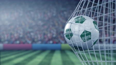 reaching : Flag of Saudi Arabia on the ball in football net. Conceptual 3D animation Stock Footage