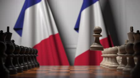 стратегический : Flags of France behind chess board. The first pawn moves in the beginning of the game. Political rivalry conceptual 3D animation Стоковые видеозаписи
