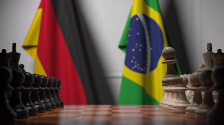 bandiera brasiliana : Chess game against flags of Germany and Brazil. Political competition related 3D animation Filmati Stock
